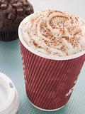 Cup Of Hot Chocolate With A Double Chocolate Muffin