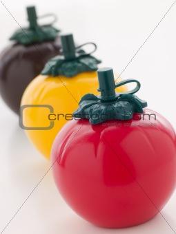 Three Tomato Shaped Sauce Bottles