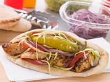 Marinated Chicken Kebab In A Pitta Bread With Salad And A Pickle