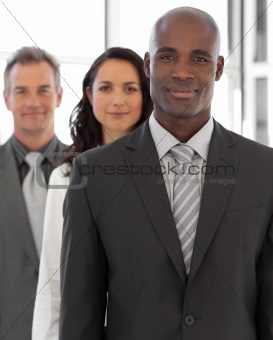 Business leader with team in the background