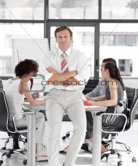 Business manager leading a team of workers
