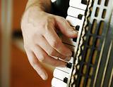 Musician hand playing accordion