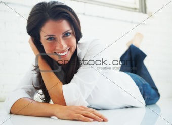 Happy woman relaxing on the floor