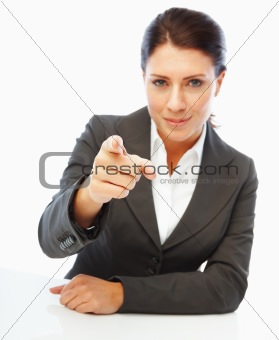 Portrait of a successful young business woman pointing her finger