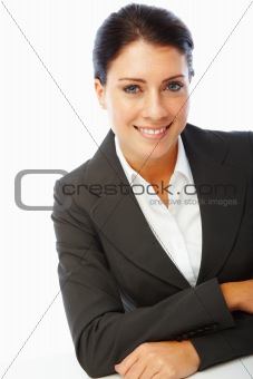 Charming young business woman with hands folded over white background