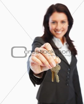 Portrait of young business woman holding keys