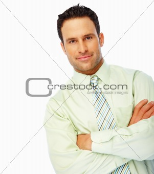 Confident business man standing with hands folded over white background