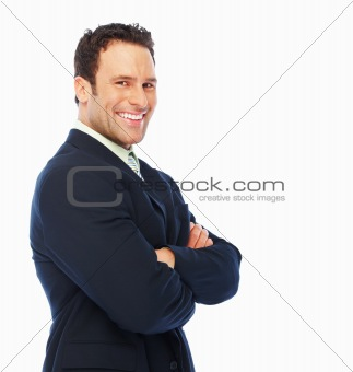 Handsome business man standing with hands folded on the white background