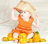 Infant with pumpkins