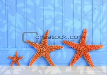 Three Starfish On Blue Background