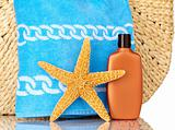 Straw Beach Bag, Blue Towel, Sunscreen and Starfish