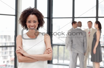 Potrait of a Beautiful Business woman smiling in from of Business team