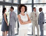 Business woman with Folded arms in Front of Business team