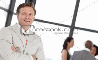Potrait of a business man in front of team