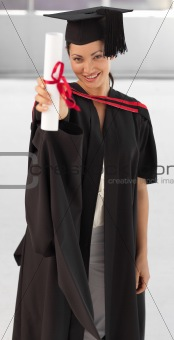 young woman Graduating holding her Diploma