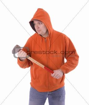 standing men in orange sweatshirt  keeping big hammer