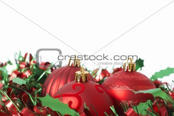 Three Red Christmas baubles on tinsel