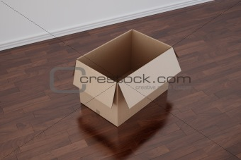 Cardboard box in empty room with dark floor