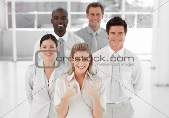 Female Business Leader with Thumbs up to camera