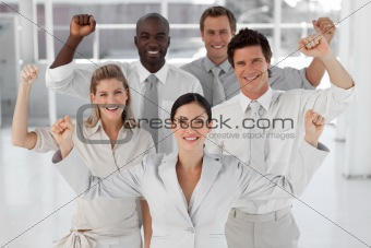 Business Team Smiling and Holding up Thumbs to camera