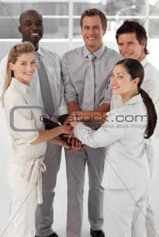 Businessman with businesswomen with folder-arms