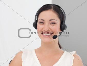 Beautiful International Business woman on a Headset smiling