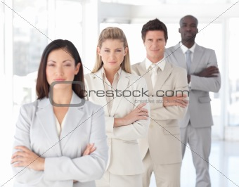 Business team in a row looking serious