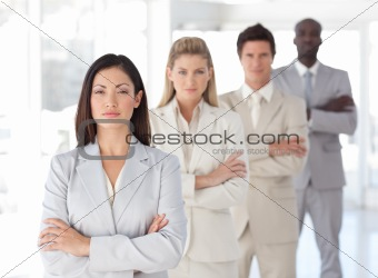 Serious Business leader in front of Team