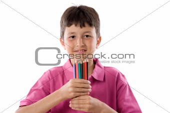 Adorable boy with many crayons of colors
