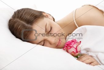 The sleeping girl with a flower