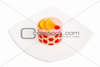 Cake with a cherry and an orange