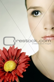 Beautiful young girl with gerber flower