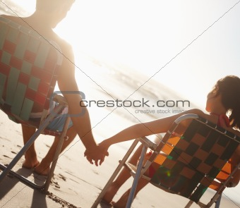 Young couple relaxing by the seashore