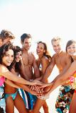 Group of people at the beach with their hand together