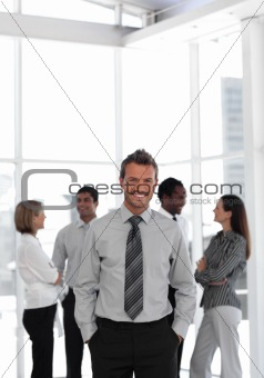 Potrait of a businessman standing before team