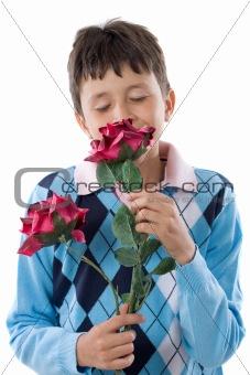 Boy smelling a flower
