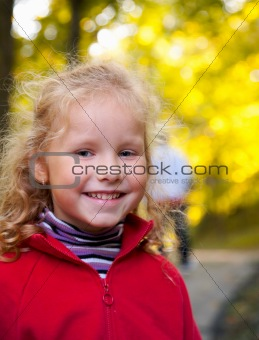 Small girl in autumn park