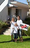 Happy Family holding Sold Sign