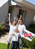 Family happy to have bought a home