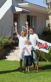 Family in front of House for sale
