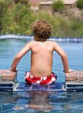 Boy on the edge of a swimming a pool