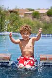 Boy Splashing in a Pool