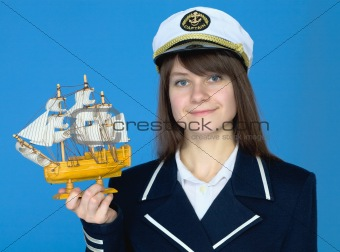 Portrait of the woman in a sea cap with the ship