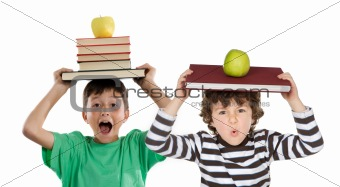 Adorable children with many books and apple on the head