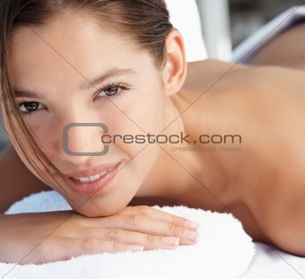 Beautiful young lady receiving massage at spa