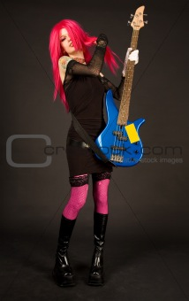 Attractive girl putting on bass guitar