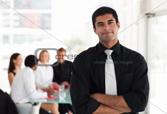 Business leader in front of his Team