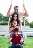 Family on a swing