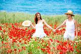 Happy young couple enjoying themselves ona meadow