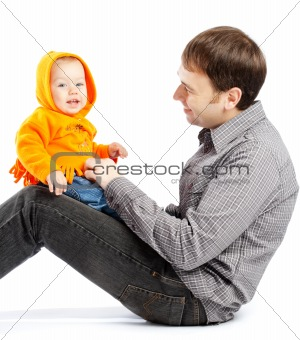 Baby on daddy's knees